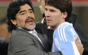 an uncomfortable hug between maradona and messi