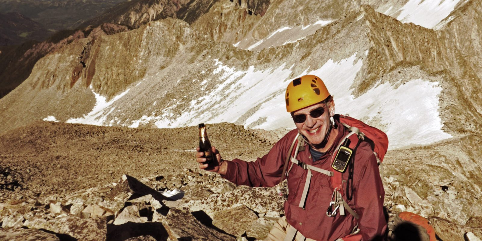 Rick Crandall enjoying a split of Prosecco after descending the most difficult part of a mountain trail