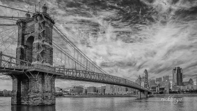 """Roebling Suspension Bridge. Selected for inclusion in """"Best of Photography 2018"""" hardcopy coffee-table book sponsored by Photographer's Forum. 2nd place award in """"Black and White"""" at international website Pixoto. """"Photo of the Day"""" at capturecincinnati.com. Honorable Mention in the Digital Art category at the November, 2018, Middletown Art Center exhibition. Selected for Harvest Home Fair exhibition 2018 and Mapleknoll Exhibition 2019."""