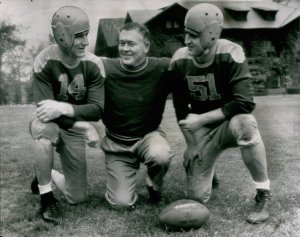 Curly Lambeau with Don Hutson (14) and Irv Comp--1944