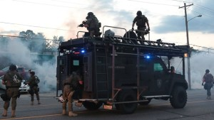 Tactical officers fire tear gas into the crowd Ferguson MO  8-11-14