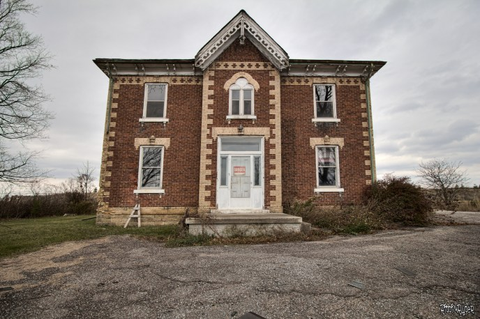 Outside the abandoned century home