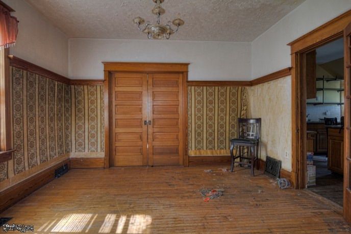 Dining Room of the abandoned homestead with pocket doors