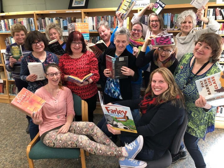 The staff team of the Rideau Lakes Public Library - waving books and smiling.