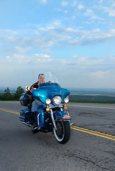 Mike Youngpeter cruises on his Harley Davidson south of Stigler.
