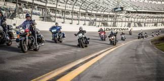 Harley-Davidson takes a group of military personnel and first responders on a ride around Daytona International Speedway.