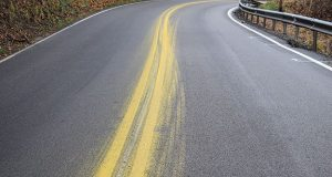 Silicone, reflective glass beads used in road striping paint can be extraordinarily slippery. Avoid riding through splatters, overspray and any paint tracked onto the road surface, especially in curves.