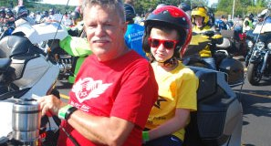 Brain tumor survivor Levi (right) is ready to ride in New England.