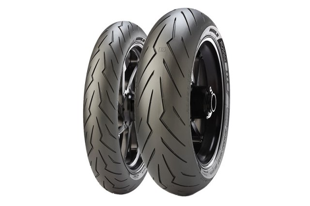 Sport tires do one thing very well: grip the pavement during aggressive riding, especially when cornering. Sport tires usually feature fewer tread grooves, putting as much rubber on the ground as possible. The Pirelli Diablo Rosso III has a dual compound rear that allows for longer wear down the center, with a silica side compound offering tons of grip when leaning into a corner.