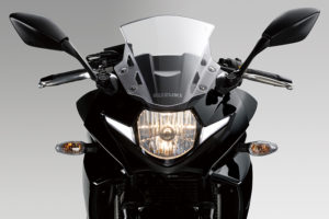 The Suzuki GSX250R's halogen headlight is flanked by LED position lights.