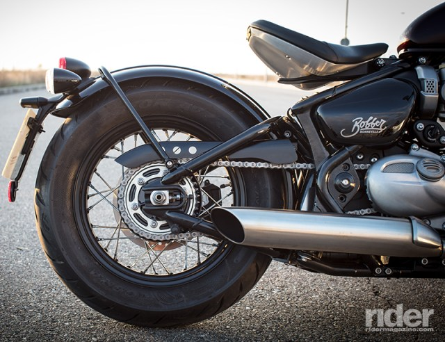 The Bobber's rear end is designed to look like a chopped up and welded hard tail. The single rear shock and linkage are cleverly hidden under the seat, leaving the whole rear fender assembly to bounce over bumps and isolating them from the rider.