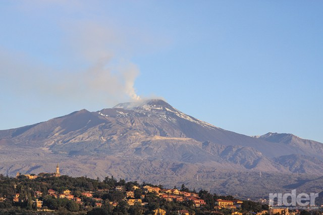 Mighty Mount Etna lets off some steam during the early morning, with the suburbs of Catania huddled along its foothills. Europe's largest active volcano also has the longest record of continuous eruption.
