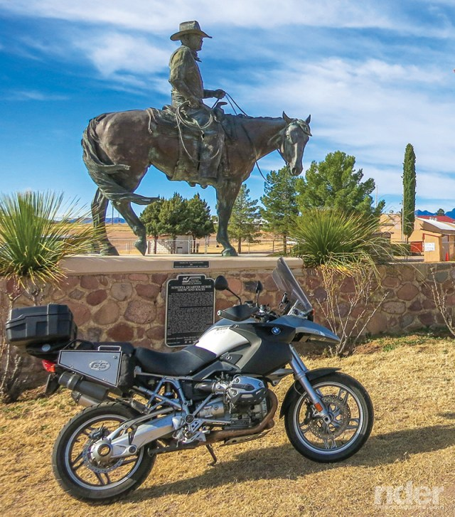 An iron horse casts a glance at a more modern version of itself.