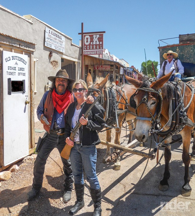 My riding partner gets up close and personal with some O.K. Corral reenactors in Tombstone