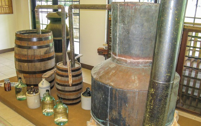 "This complete moonshine still at the Charles Hall Museum in Tellico Plains was an anonymous donation; it just showed up one morning. Note the thump keg; don't overfill or it may ""puke through."""