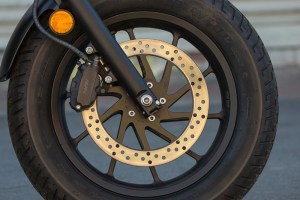 In a nice touch, the Rebel's front brake disc carrier is cut to match the cast wheel's spokes, for a clean look.