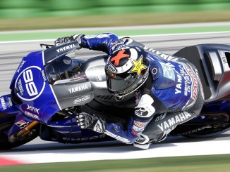 Yamaha MotoGP rider Jorge Lorenzo of Spain takes a curve during the qualifying session on his way to get second place on the starting grid for the San Marino motorcycling Grand Prix at the Misano circuit