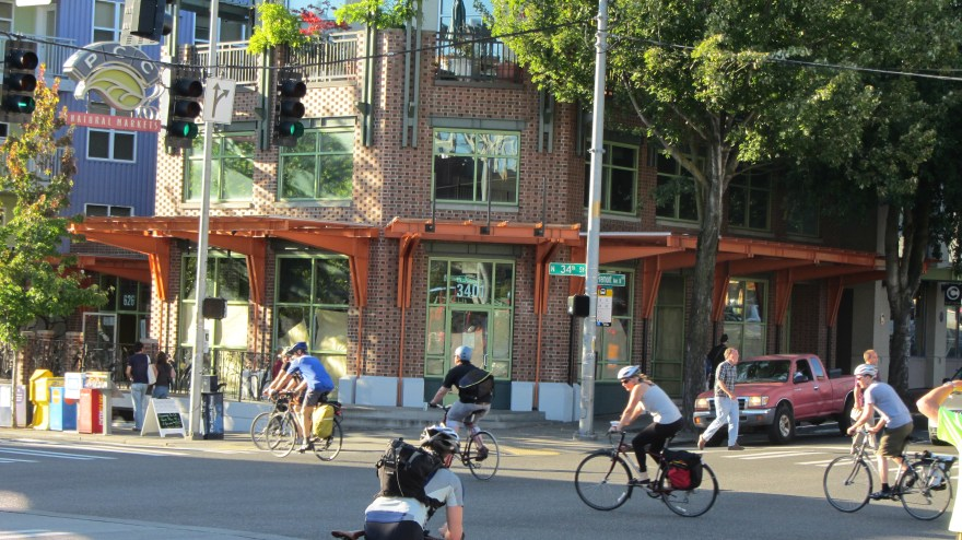 people riding a variety of bikes in Fremont on sunny day