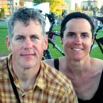 Anne and TIm at SLU Park on our way home from a 10-day family bike tour