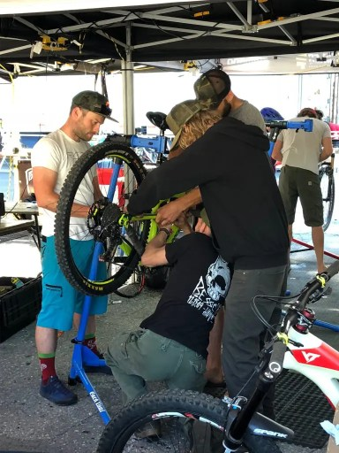 mechanics working on a bike at BC Bike Race