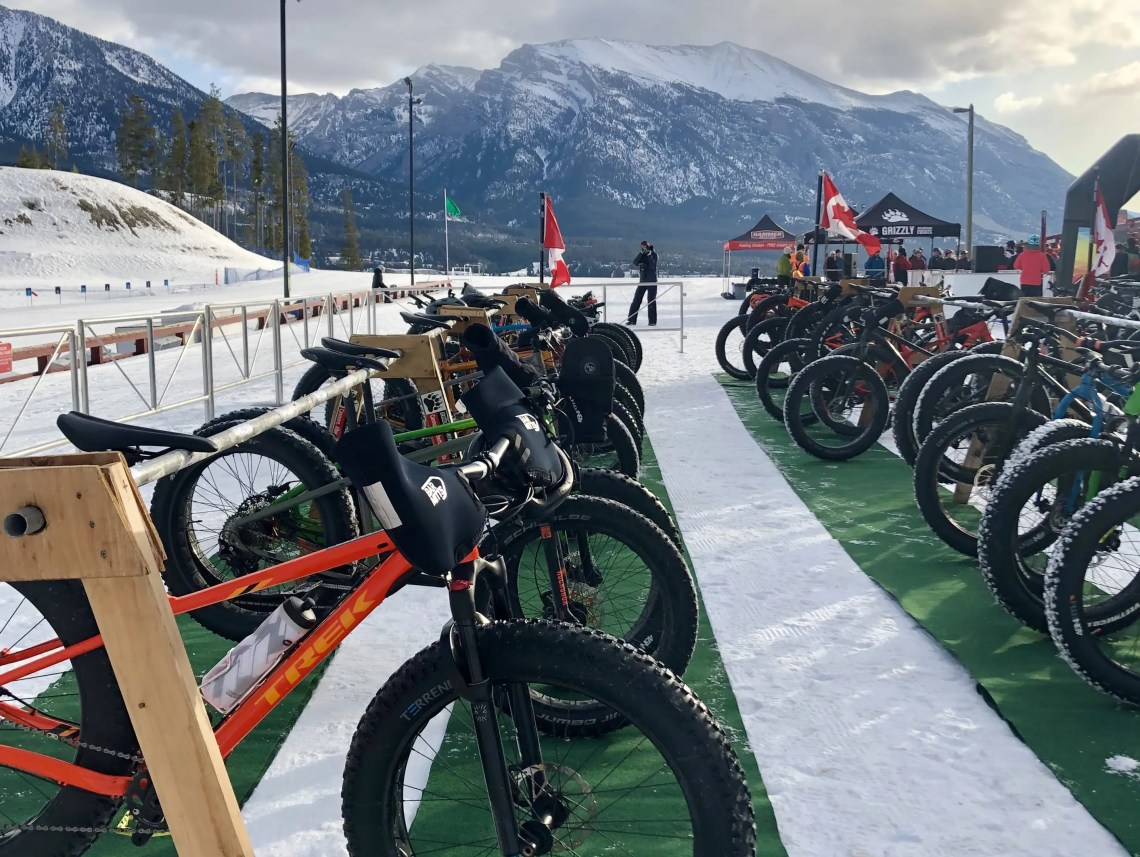 Racks full of fat bikes ready to race
