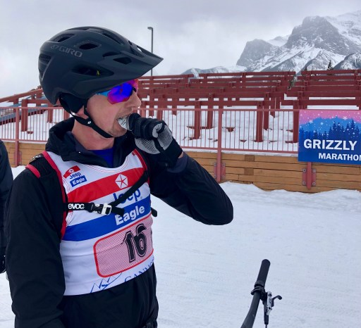 stopping for a quick gel during a fat bike race