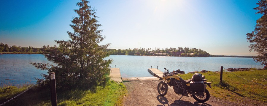 Bike parked beside a lake