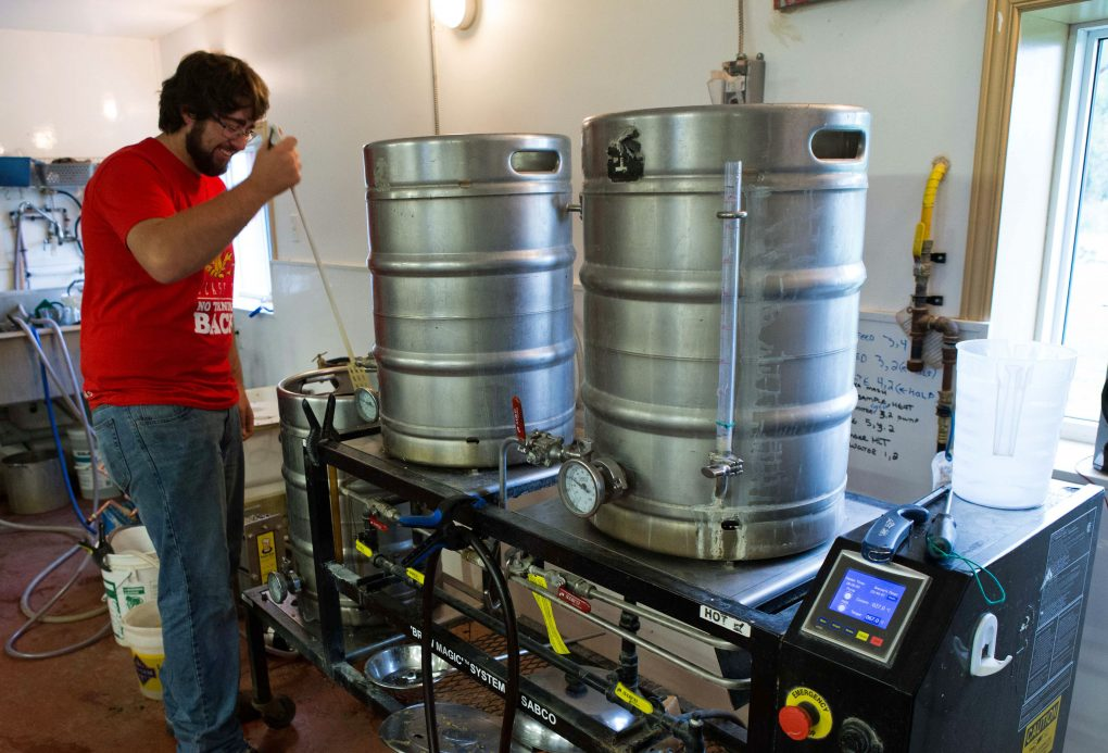 The brew-master hard at work, Whitewater Brewing Company.