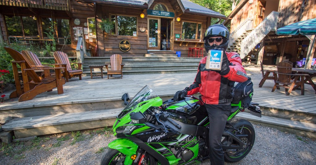 Biker holing his Madawaska Coffee