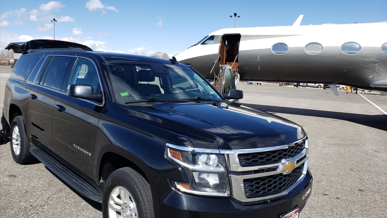 Black SUV waiting for a ride at Centennial airport
