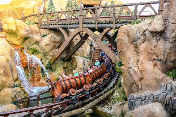 Seven Dwarfs Mine Train swooping near a waterfall