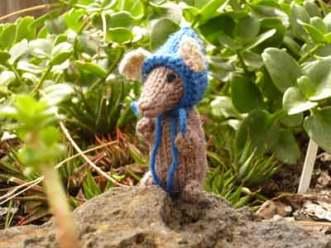 Mouse with bonnet