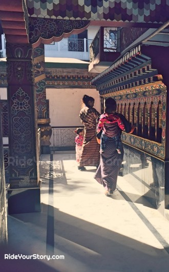 A family turning the prayer wheel