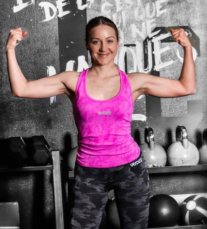 model wearing Ridge Sports fitness pink top
