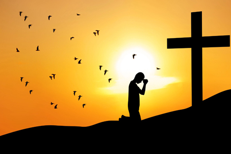 Prayer in front of the Cross