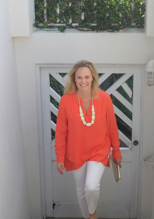 Lifestyle Blogger, Ridgely Brode wears an Orange top and White jeans on Ridgely's Radar