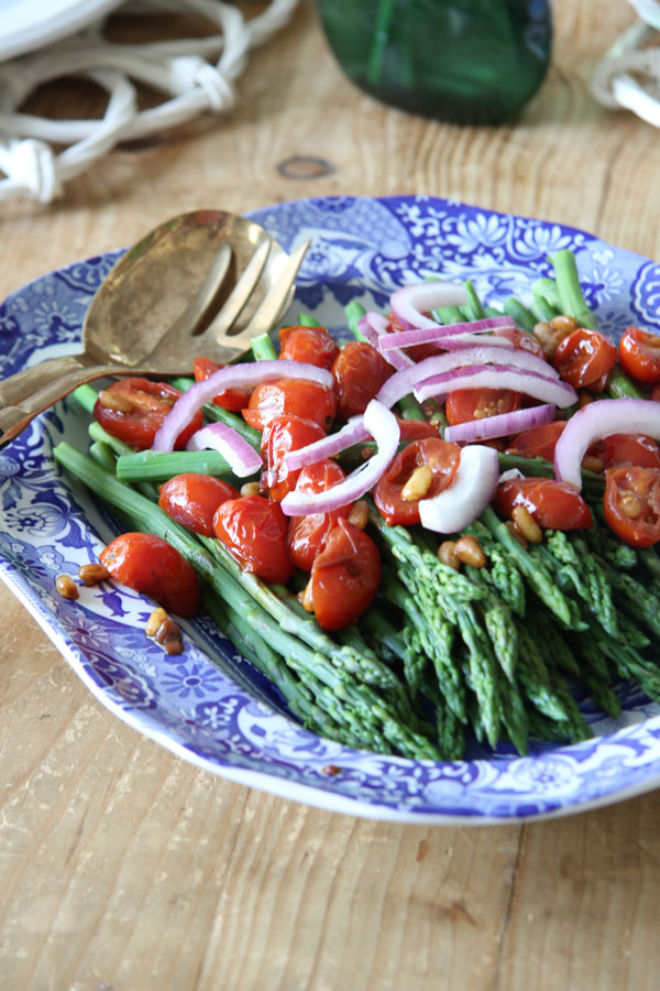 Looking for a healthy, delicious side dish Ridgely Brode makes Asparagus with Balsamic Tomatoes and Pine Nuts on her blog Ridgely's Radar.