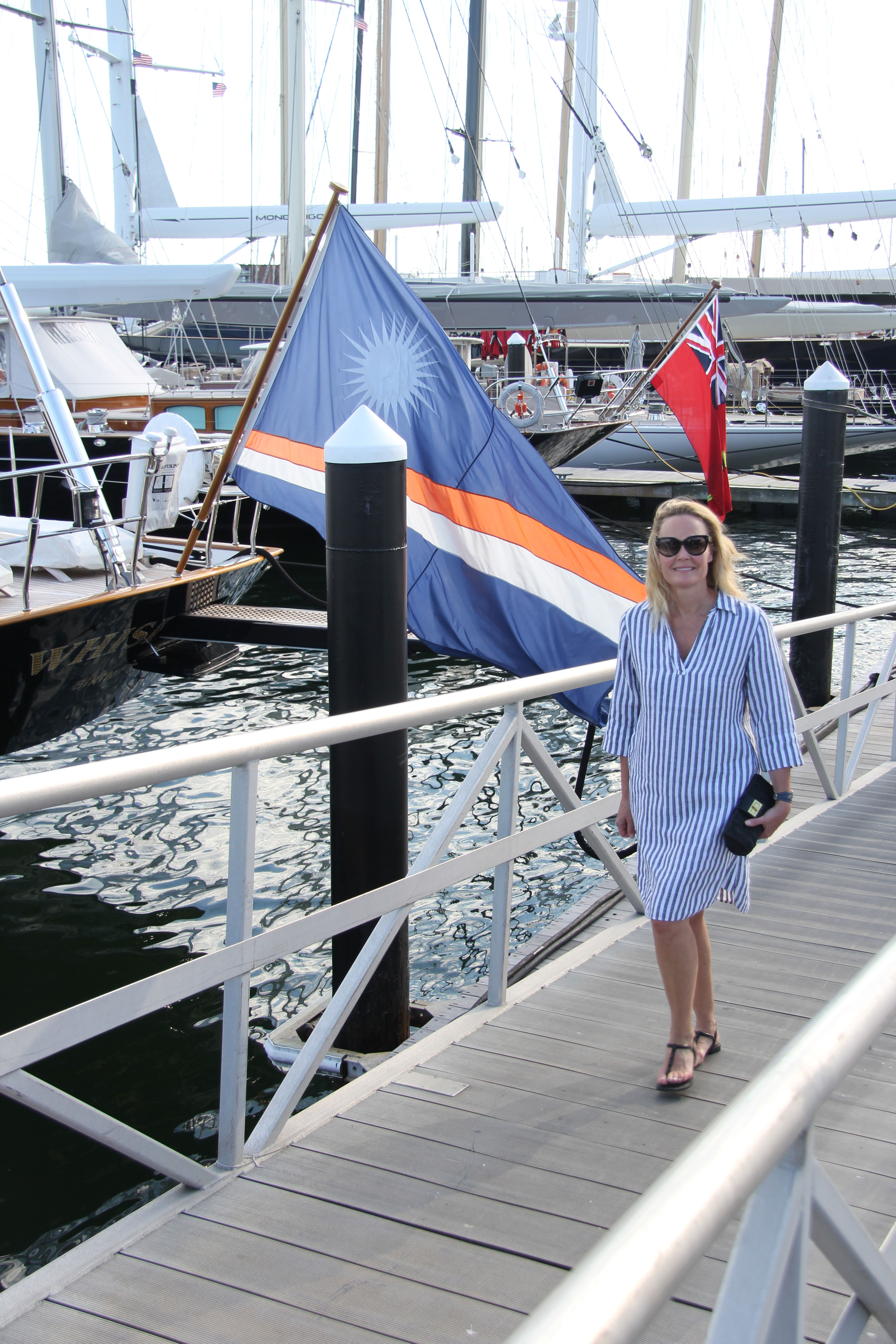 Ridgely Brode wears her Striped Nautique Dress for a stroll along the boats in Newport, Rhode Island on her blog, Ridgely's Radar.