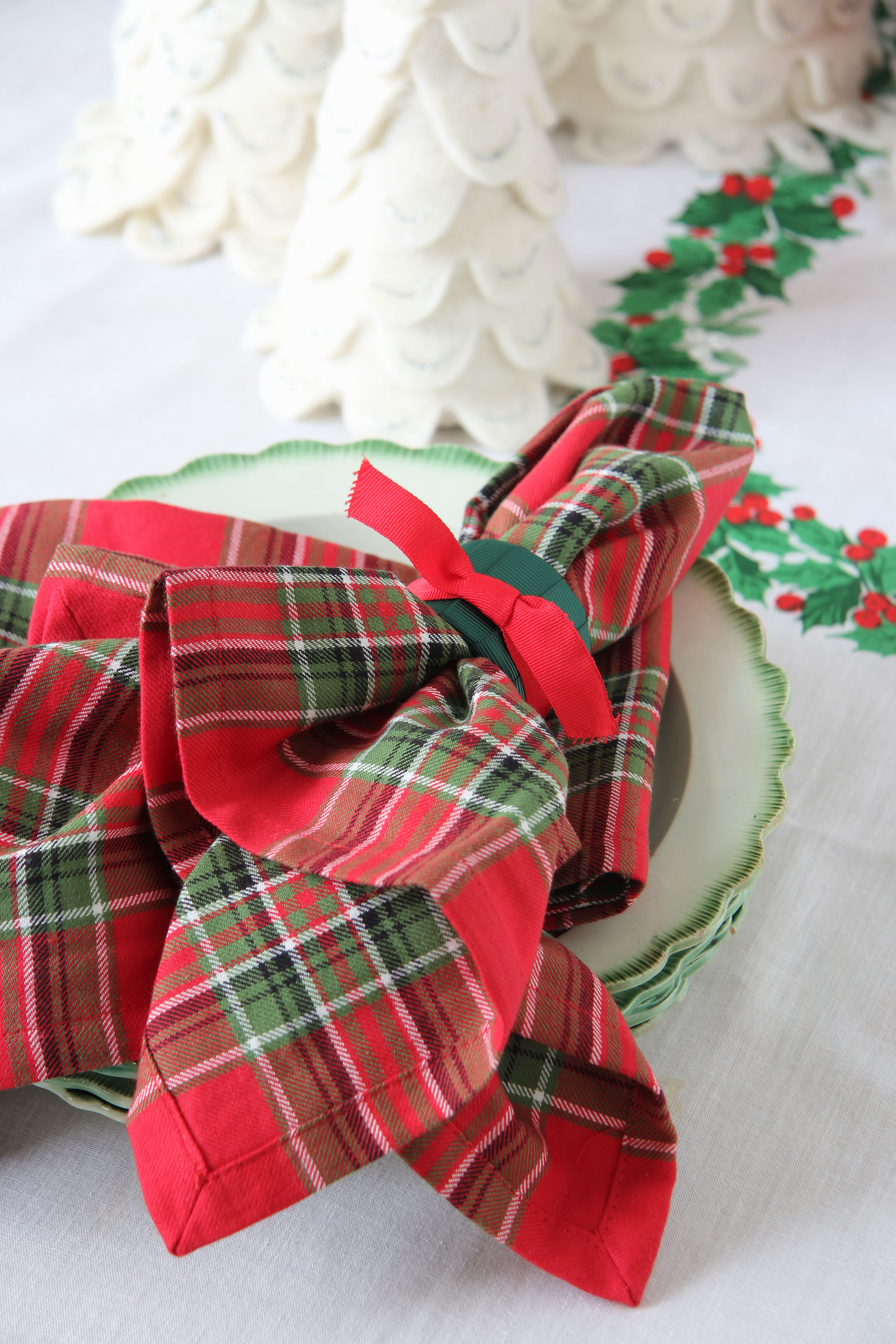 Ridgely Brode finds that mixing and matching her linens at Christmas is a fun and festive way to decorate her table on her blog Ridgely's Radar.