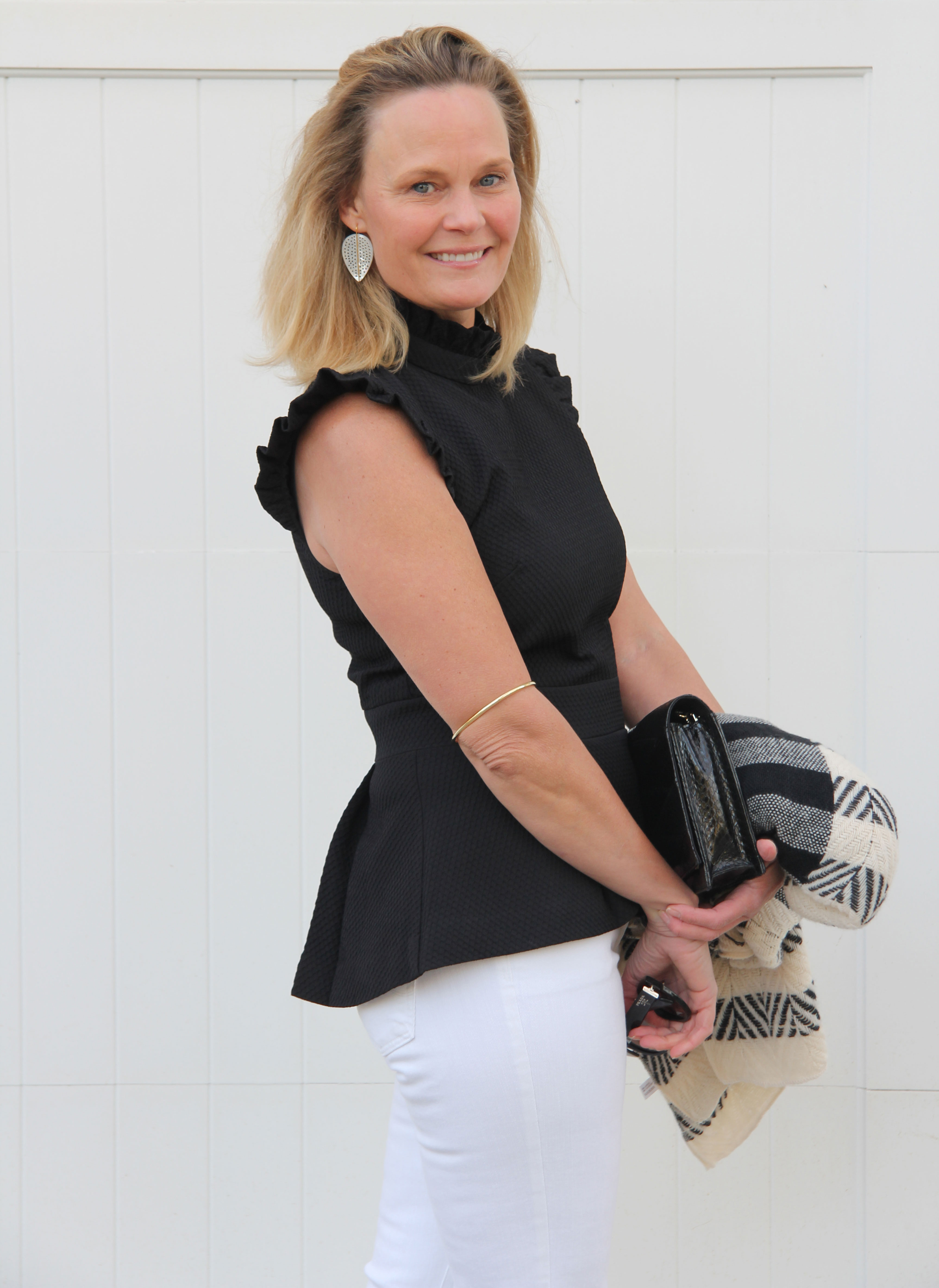 Ridgely Brode re-thinks her feelings on peplum tops and realizes how versatile and flattering they are on her blog Ridgely's Radar.