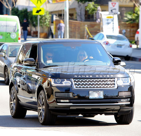 Jessica Simpson driving on Sunset plaza