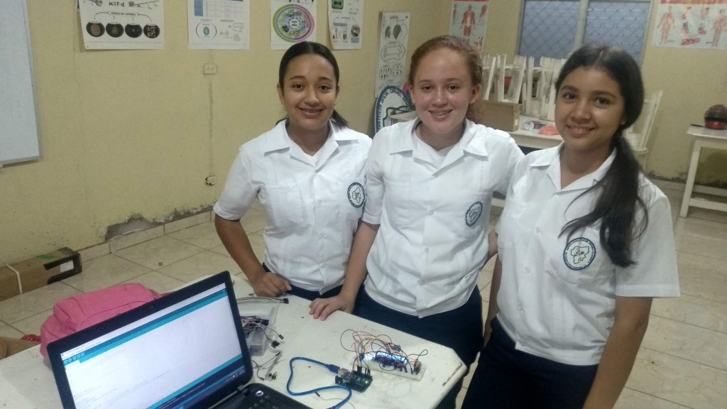 Senior students Cinthia (left), Sarahi (center), and Kensy (right) and their recently programmed temperature and humidity sensor. The sensor was built using the Arduino Platform for class project