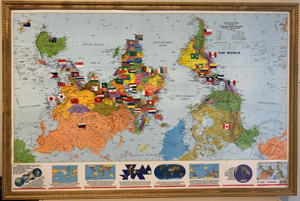 The world map in the IDD&E department with flags marking the countries from which students have come so far to study IDD&E