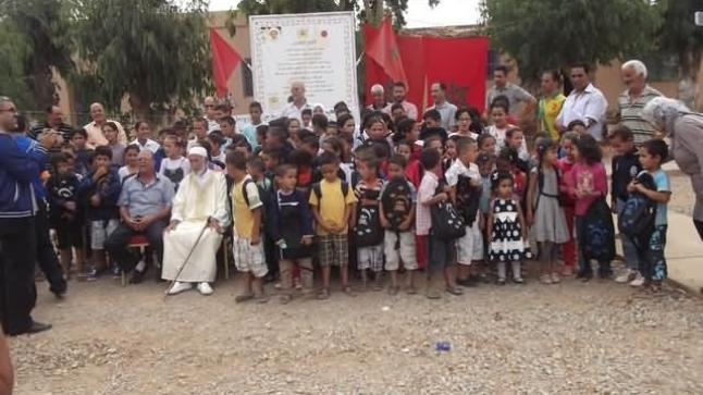 توزيع المحافظ واللوازم المدرسية على تلاميذ مدرسة مولاي علي الشريف بأركمان