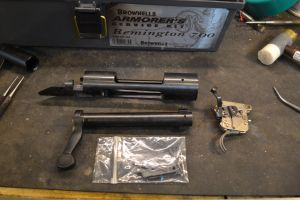 With the receiver disassembled, we secure all small parts in plastic bags to prevent loss.