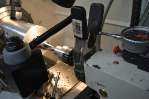 To measure the depth of cut, we attached a spring clamp to our tail stock and used a dial indicator in a magnetic base.