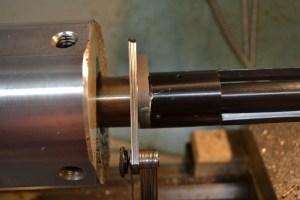 "Anti seize is applied to the barrel threads. The action and lug are threaded into place with the ""go"" gauge in the chamber. Once the action is tight against the gauge, feeler gauges are used to see how much deeper the chamber needs to be cut. The reamer stop is then adjusted to half of this depth and process repeated until the ""go"" gauge fits. When the ""go"" gauge fits, a ""no-go"" gauge is then used to verify the chamber hasn't been cut too deep."