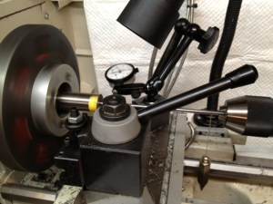 "This is the set up we use to dial in the bore. Note the plumb bob providing tension on the range rod. A .001"" dial indicator is used to center the bore inside the spider. The range rod is then backed out to the chamber end of the barrel and the outside spider is used to center it. Once the range rod indicates to within .001"", a .0001"" dial indicator is used and the process is repeated until the bore is dialied in to within .0001""."
