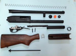 Our Remington 870 Police is now broken down so we can proceed.  Note: the slide and bolt assembly are missing from the picture.