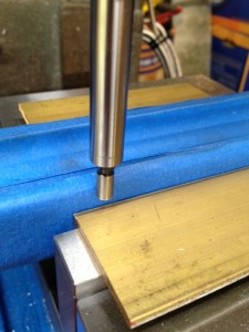 An edge finder is used to locate the front edge and sides of the stock.